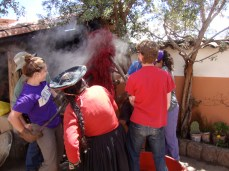 Taking the cochineal-dyed yarn out of the dye pot; next step–washing and rinsing.