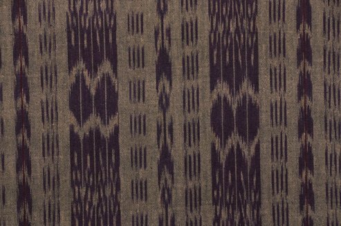 Warp ikat from Guatemala. Note the group of threads forming pattern.