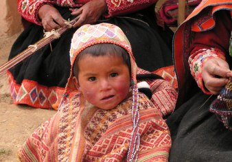 Peruvian Child wearing hand knitted hat from the village of Accha Alta.