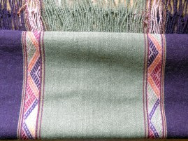 Sallac weavers first weave their cloth and then embroider designs.