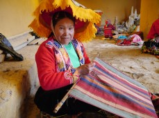 Sallac weaver embroidering her design.
