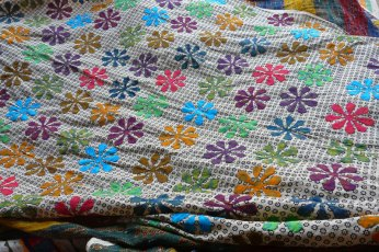 Ramu breaks with tradition in this floral pattern.