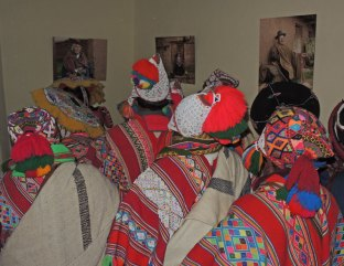 Weavers from the Peruvian Highlands viewing the portraits of the Elders.