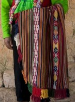 Watay and embroidery used together in a poncho.