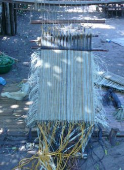 Weaving raffia on a simple upright tilted frame.