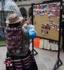An artisan from Huancavelica takes photos of the communities' colored-stripe wrappings.