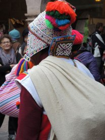 The men from Huacatinco, Peru, adorn their knitted hats and collars with beaded designs.