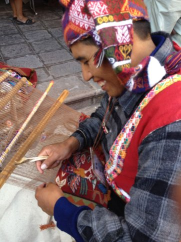 A weaver from Pitumarca, Peru, demonstrates the unique style of tapiz (tapestry) weaving.