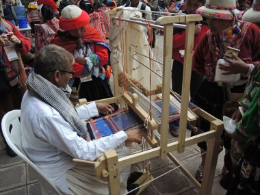 Peruvian weavers watching Dayalal Kudecha from India weave his traditional motifs. Tinkuy 2013.
