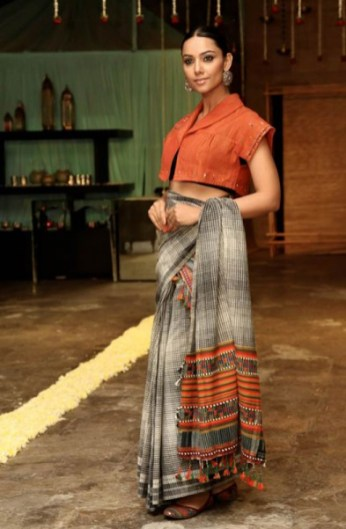 Dayabhai's contemporary interpretation of traditional design woven into a sari cloth and worn during a fashion show. Photo courtesy Judy Frater.