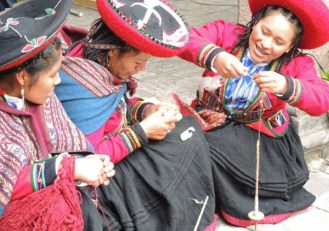 Chinchero young women chat while spinning away.