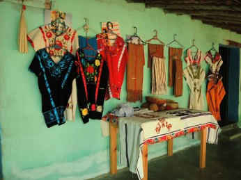 The small shop at the sister's home in Huazolotitlan featuring some handspuns and woven cloth along with embroidered huiples.