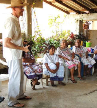 Eric wearing his handwoven gift of brocaded handspun organic cotton. Margarita (in all white huipil), Florentina's niece, translated between Spanish and Amuzgo.