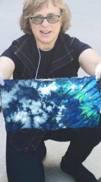 Cathie Joslyn with resist-dyed indigo cloth that's still oxidizing.