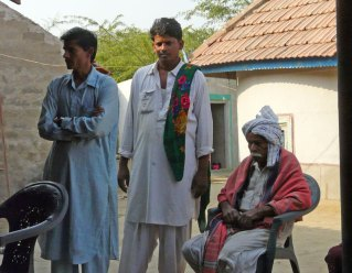 Ramu Devraj Harijan (center) of the Banni region of Kutch, India along with his brother (left) and his father (right).