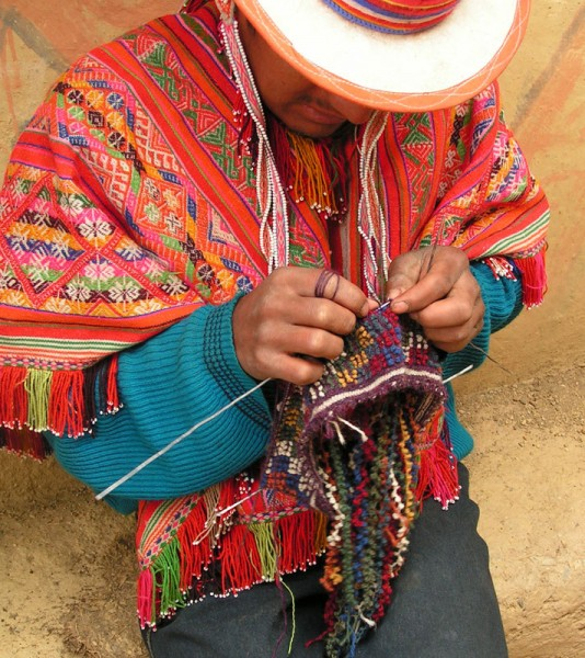 "An Accha Alta man knitting the ""bobble"" hat."