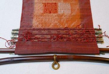 Fold the cloth around the rod.
