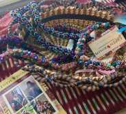 Handmade silk button necklaces from Madagascar, pine needle baskets from Guatemala.