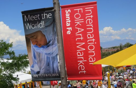 The Folk Art Market banners rise above the crowds.