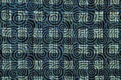 Indigo-dyed silk with spiral woodblock pattern.