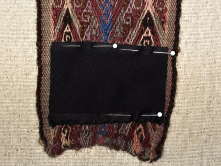 Pin the sleeve along the design following the weft line in preparation for stitching.