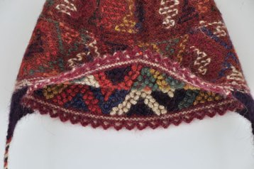"An inside out view of the hat--the wrong side of the hat is a smooth surface and the right side shows unique ""popcorn"" pattern creating an overall textural surface."
