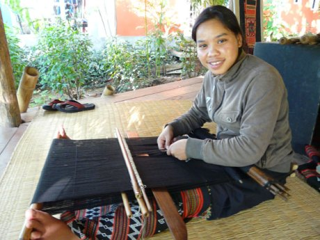 Mone Jouymany weaves traditional backstrap bead weaving at Ock Pop Tok in Luang Prabang, Laos.