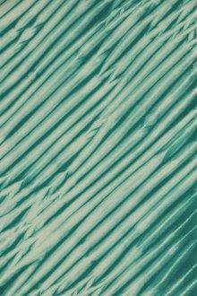 Diagonally-wrapped arashi shibori.