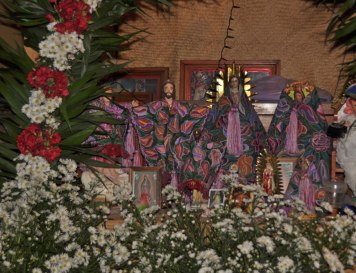 Embroidered textiles shroud the holy figurines.