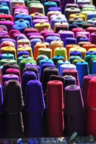 These synthetic yarns are used in weaving the base fabric for the shalws, skirts, men's tunics, and other woven products. They're also used for stitching large embroidered patterns on table runners.
