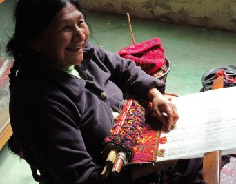 Maria Meza Guzman demonstrates brocade weaving on her backstrap loom. Notice the short pile loops.