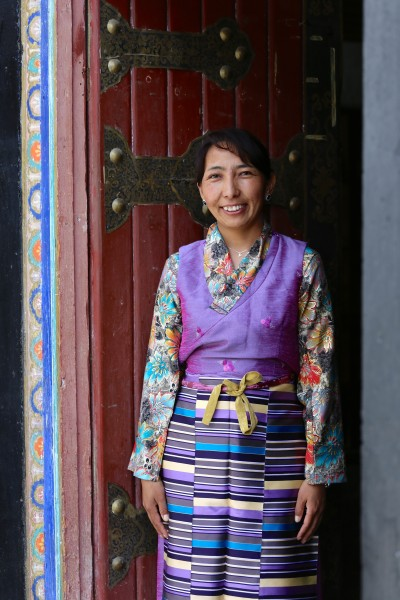 Artisan Panchoe in the doorway of Dropenling's store in Lhasa. She works in the marketing department.