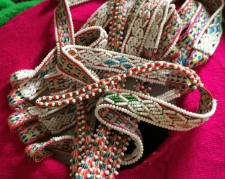 Detail of the beaded woven bands on the women's hats.