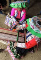 Weaving traditional pattern on backstrap loom in Huacatinco, Peru