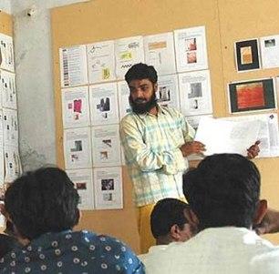 Aziz Khatri making a design presentation while attending Kala Raksha Vidhylaya.