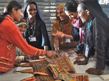 Studying heritage textiles, India.