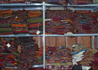 The storage room as CTTC brimming with woven textiles.