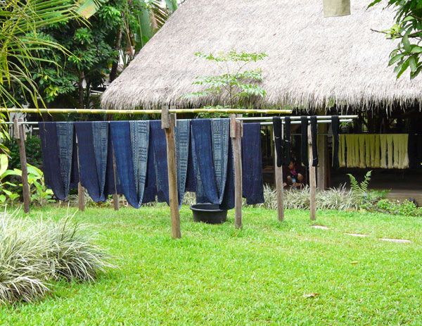 After the fabric is indigo-dyed, it's looped over poles to dry in the sun, and to ensure colorfastness.