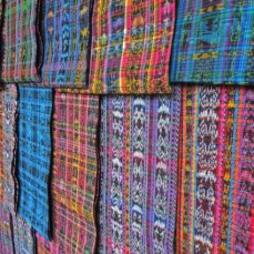 A wall of jaspe (a complex tie-and-dye technique) at the market in Momostenango.