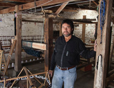 Juan de Dios in weaving studio. Photo credit: Joe Coca