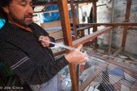 Juan de Dios makes cross to separate warp threads afor his jaspe cloth. Photo credit: Joe Coca