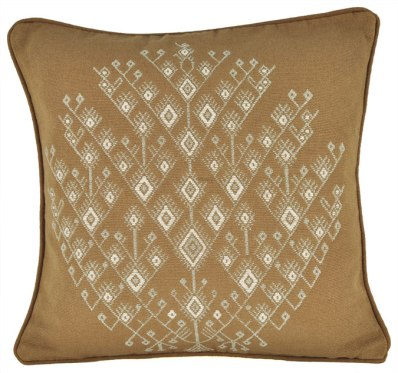 The Tree of Life, backstrap woven in natural cottons, covers the surface of this pillow.