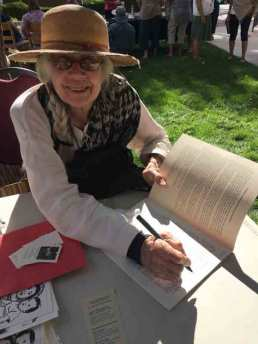 Marilyn Anderson signs her new book.