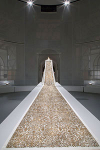 Karl Lagerfeld's stunning haute couture wedding dress is a tour de force of techniques and materials, including gold paint, pearls and gemstones. The 20-foot train took 450 hours to execute.