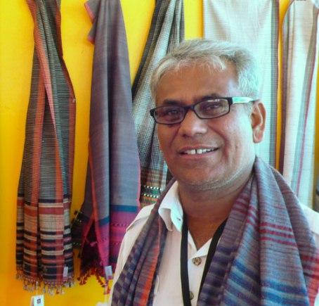 Dayalal Kudecha in his booth at the Santa Fe Folk Art Market.