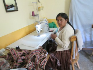 Vilma earns income weaving and sewing the yoga mat straps in the PAZA workshop.