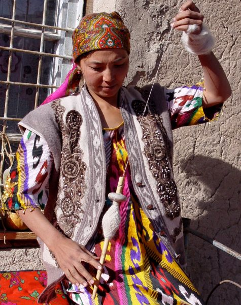Tajikistan woman spins on a spindle.