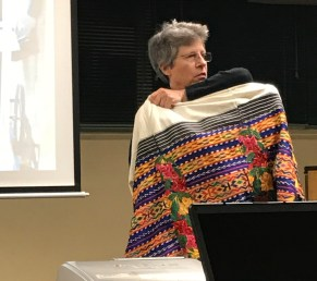 Deborah Chandler showing an intricate huipil both woven and embroidered.