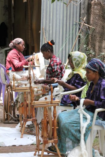 Ethiopian women spinning on modern spinning wheels. Photo courtesy Creative Women.