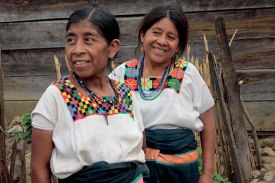 Maya women in huipils with patterns used for 200 years.